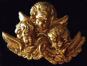 three gold angel busts